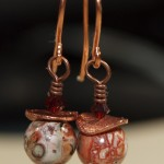 Earrings by Kym Hunter, with wavy copper disks