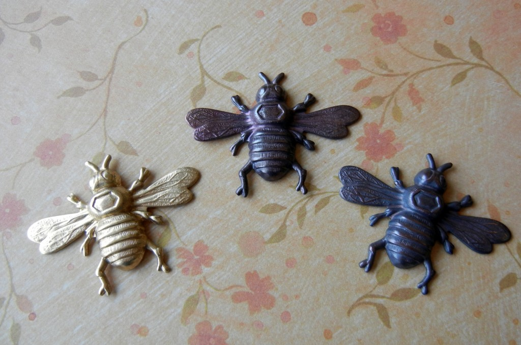 bee charms, raw and with heat patina