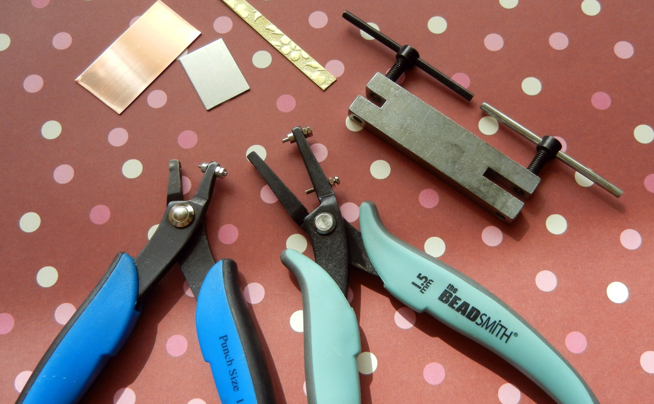 From left to right: EuroPunch pliers, BeadSmith punch pliers, screw-action hole punch