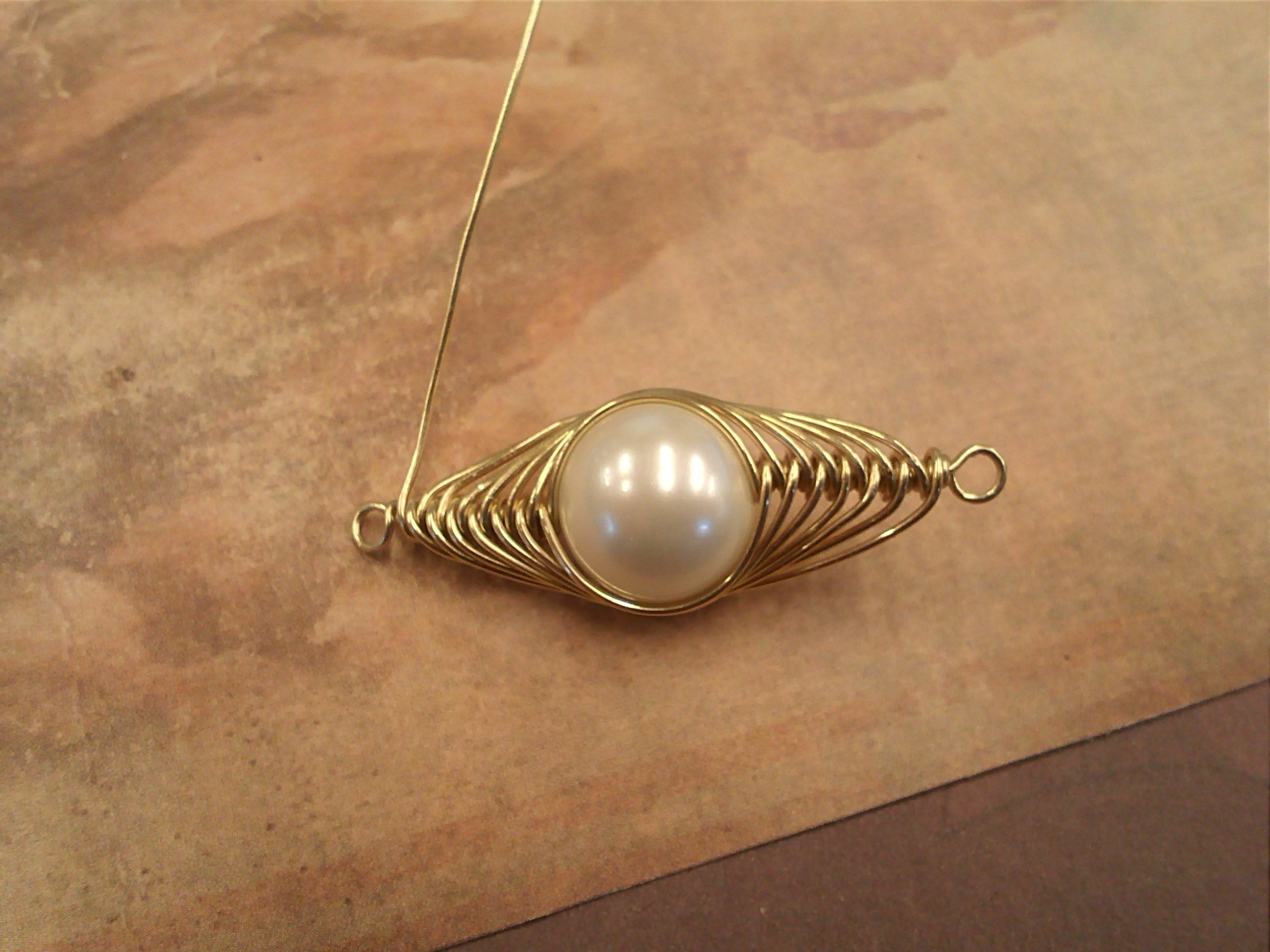 Step 7 of How To Make a Herringbone Wirewrap: Do about 6 or 7 wrap on each side.