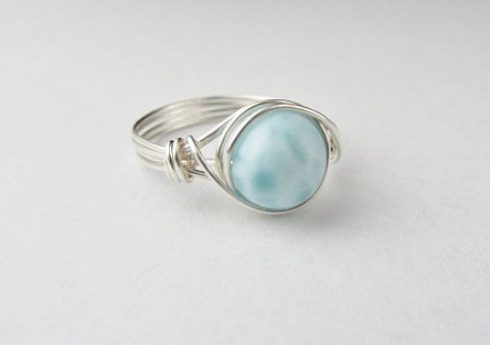 The pretty wire wrapped ring includes a stunning Larimar bead. This piece is from Sara at Blue Soul Designs.