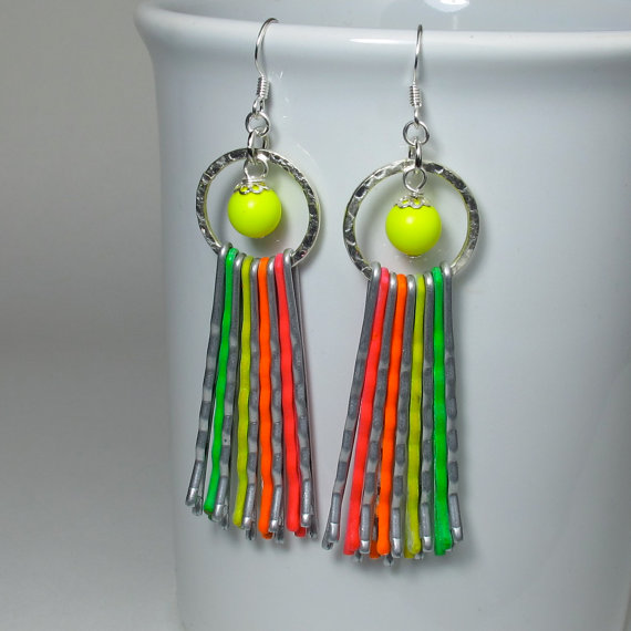 I adore these long neon earrings by Heather at BlueKat Designs. Look close and see if you can tell what they are made out of!