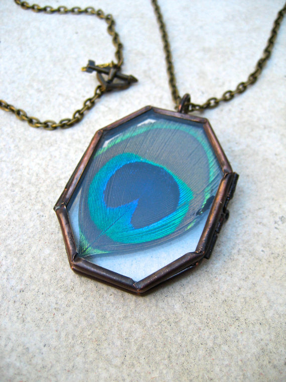 This necklace by Jen Gers of Piece Lust features a pendant that frames a real peacock feather! How cool is that?