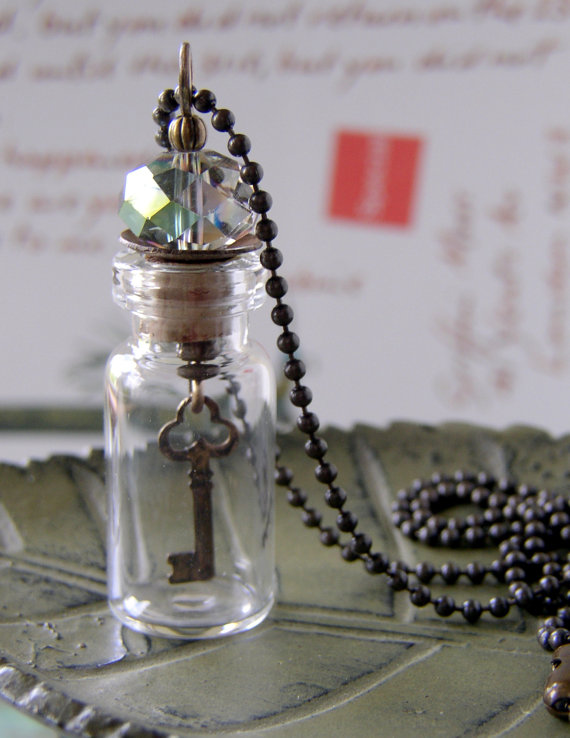 This necklace is so fun! It has a cute skeleton key suspended in a small glass vial. This piece is by Mollie Valiente of Ethereal Girls.  Her shop features tons of unique mixed media jewelry.