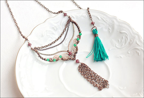 This beautiful necklace has a chain tassel on the front and a teal tassel on the back. Plus the wire work is just amazing! It can be found at the etsy store SabiKrabi.