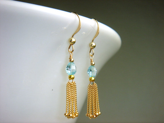 I love the combination of blue topaz and shiny gold in these dainty tassel earrings! You can find these earrings in the shop, Taylor Made Jewelry.