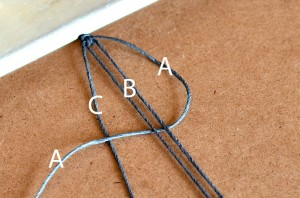 Starting a square knot.