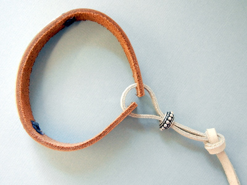 How to make an adjustable drawstring closure for a leather cuff bracelet.