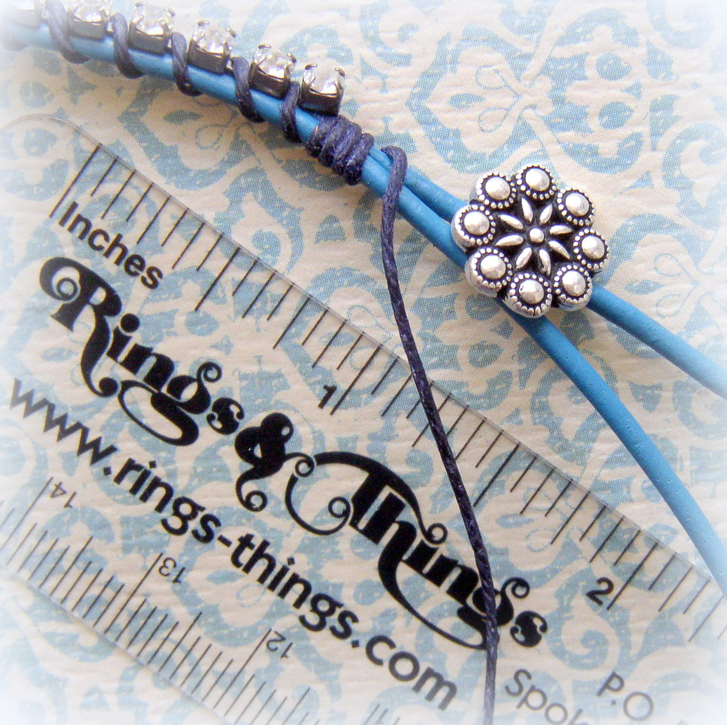 DIY Jewelry Tutorial Rhinestone and Leather Bracelet step 5 finish lashing the rhinestone to the leather cord.
