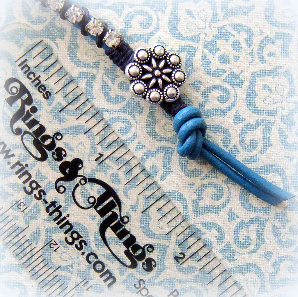 Tutorial Rhinestone and Leather Bracelet adding the final knot to finish the bracelet.