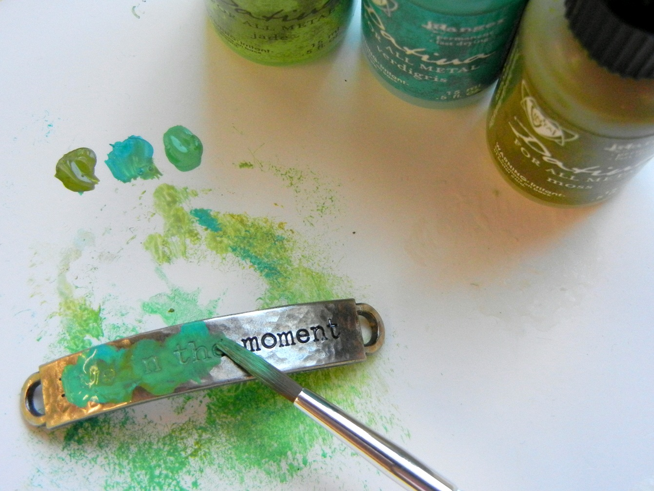 For a splash of color, paint the idea-ology word band's script with Vintaj patina.