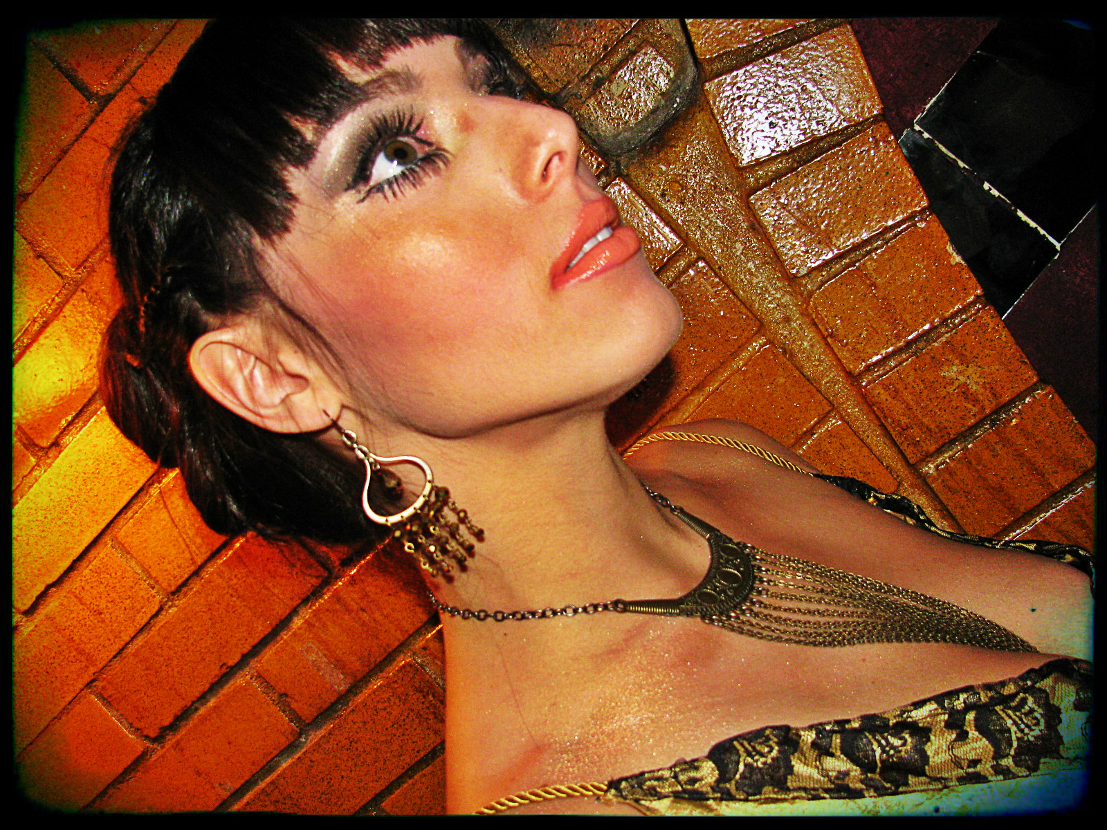 Savannah Prochnau had sparkly golden chandelier earrings and a necklace with several pieces of antique brass chain.