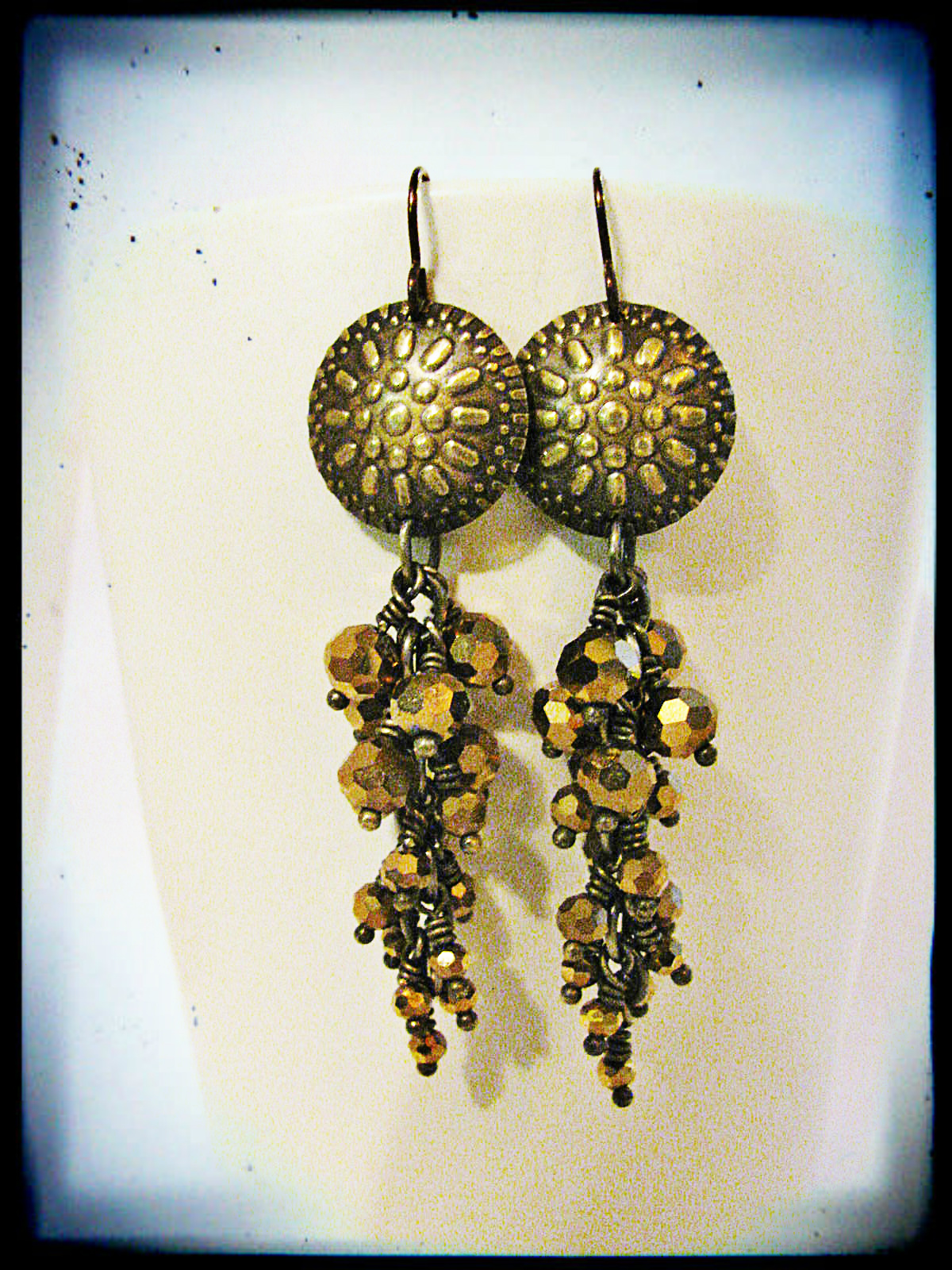 Close up of the earrings I made. These feature sparkly gold glass beads that I got from Rings & Things.