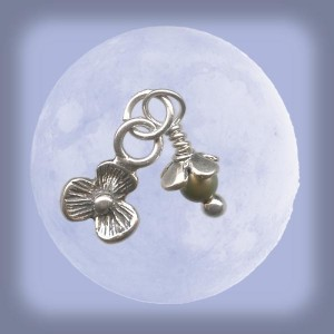 The delicate sprout charm features a Swarovski pearl, a sterling silver flower charm, a sterling silver flower bead cap, and a sterling silver ball-end head pin (available at www.rings-things.com.)
