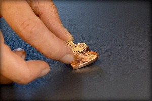 Jewelry making tutorial: how to make a clear resin image pendant from www.rings-things.com. Adding the image to the bezel.
