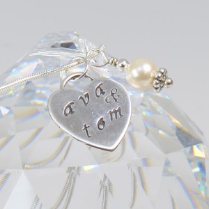 """Ava's Big Day"" hand stamped sterling silver pendant."