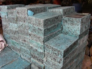 Large pile of manmade imitation turquoise block at a Chinese Materials seller visited by Russ Nobbs in 1996.