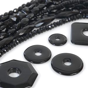 "Black onyx is treated with sugar and ""carmelized"" with heat."
