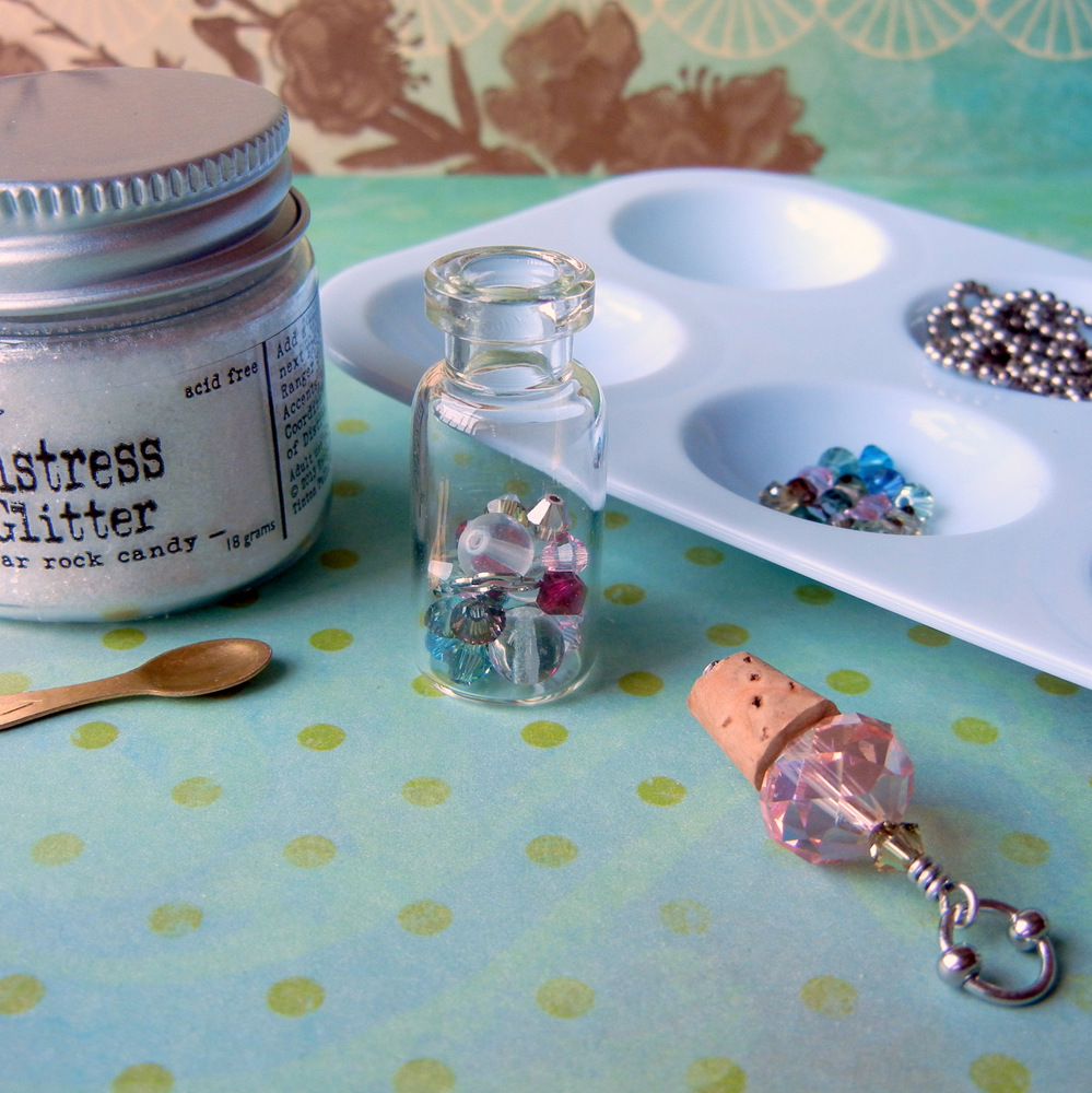 Fill your vial necklace with beads, crystals, and charms. DIY instructions to make a vial necklace at www.rings-things.com