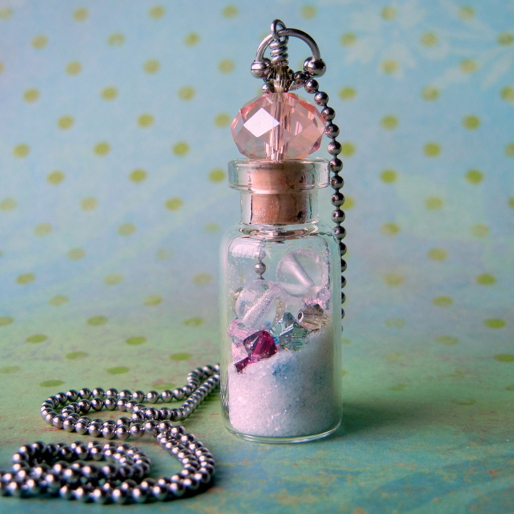 Finish your beaded vial necklace with ball chain. Easy jewelry-making instructions from Rings & Things.