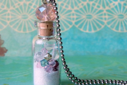 """Beachcomber"" Vial Necklace by Rings & Things' designer Mollie Valente, features a sparkly beaded cork. Vial necklaces are the perfect container for small keepsakes."