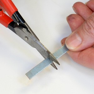Cut the Metal Strip with Shears