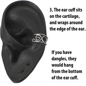 The ear cuff sits on the cartilage, and wraps around the edge of the ear.