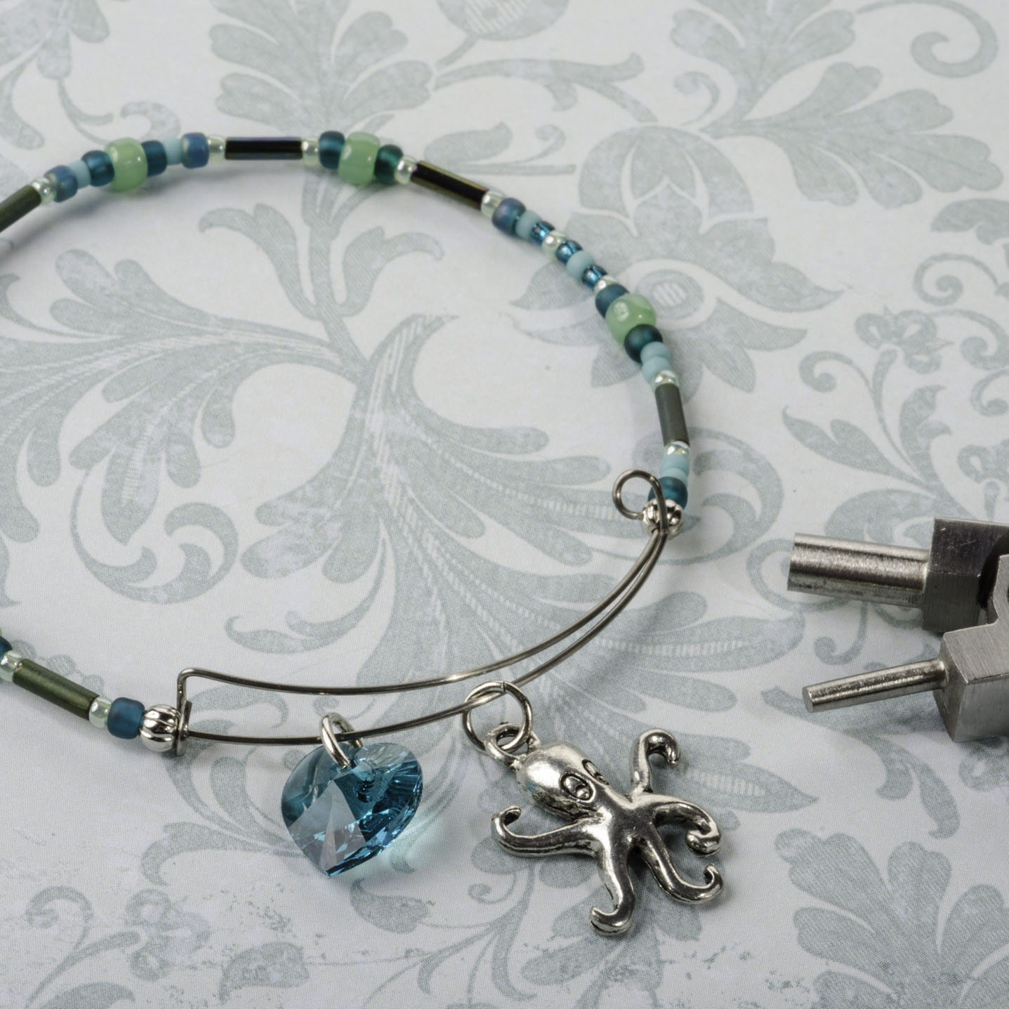 how to put charms on a bangle bracelet