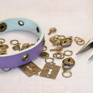Start with adding eyelets to a leather bracelet, then add the fun!