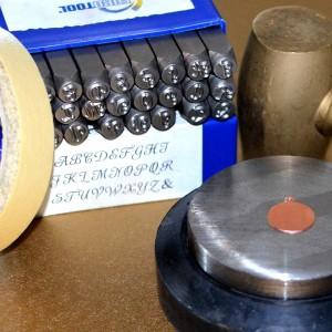 Supplies for metal stamping a charm.