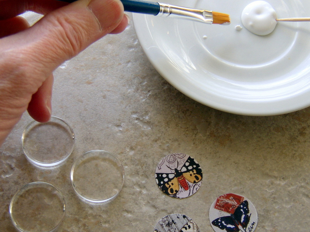 How to make image jewelry: applying the adhesive. A free DIY jewelry making tutorial from www.rings-things.com.