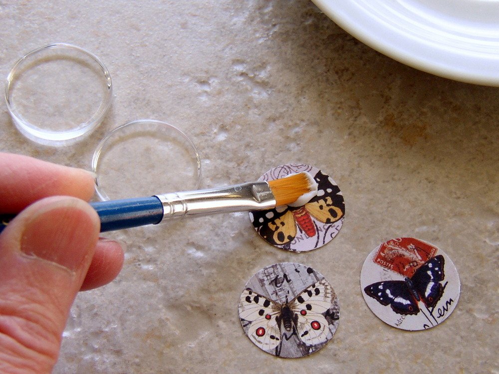 How to make image jewelry: appling adhesive glaze to the image.