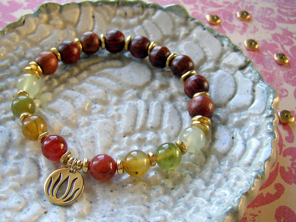 Easy to make Yoga Charm Bracelet made of wooden mala beads, gemstone beads, and a lotus charm from www.rings-things.com