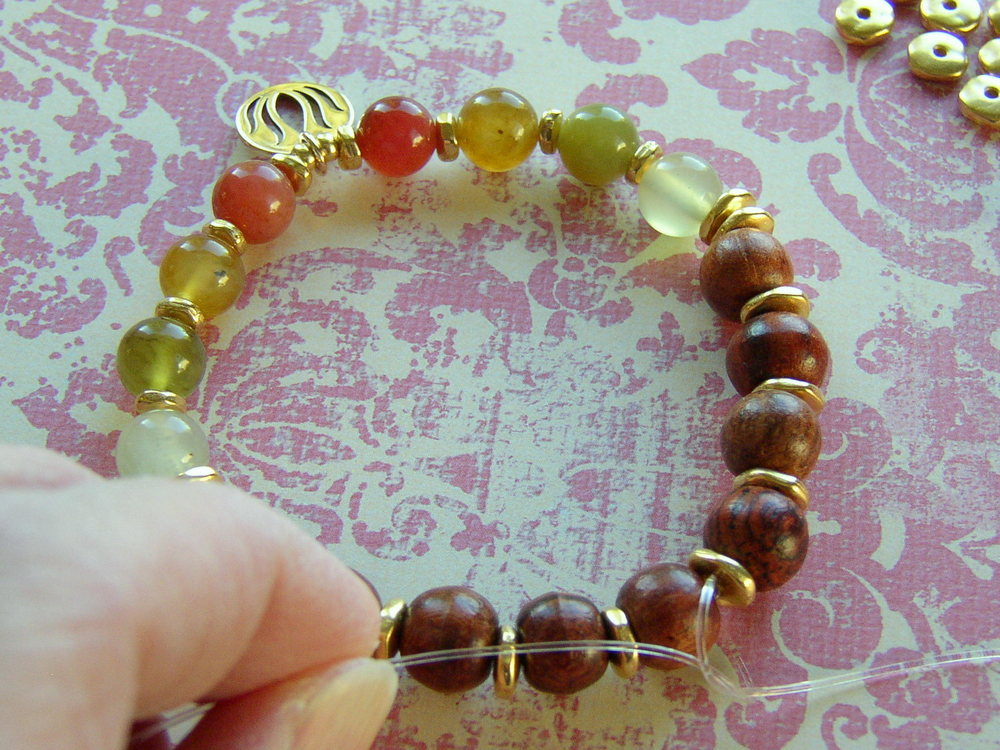 Free jewelry-making instructions.  Learn to make a Yoga bracelet.  Secure the Stretch Magic cord with a knot.