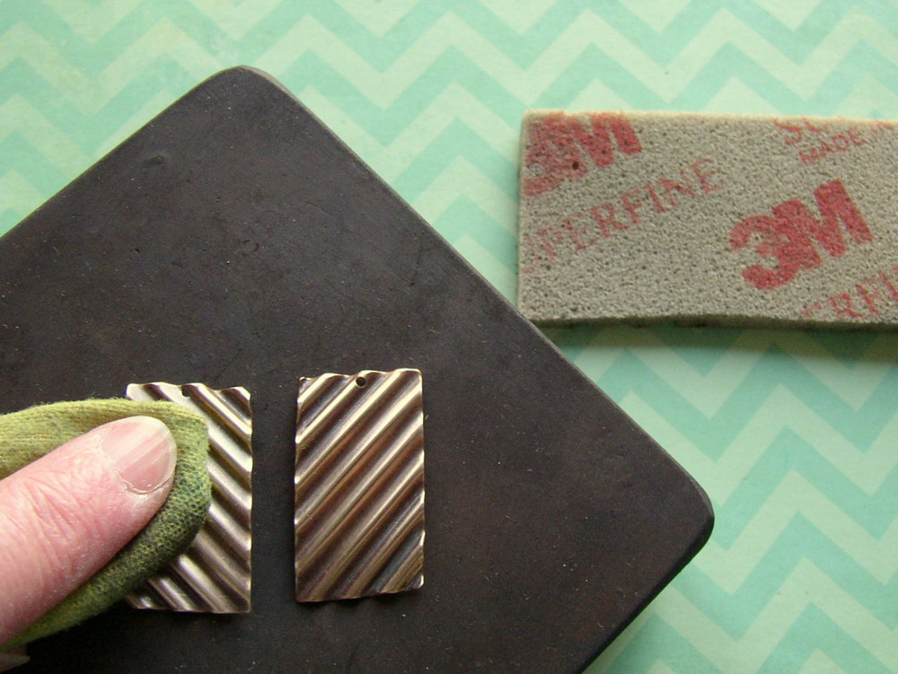 Jewelry making DIY: polish the corrugated metal blanks with a polishing cloth.