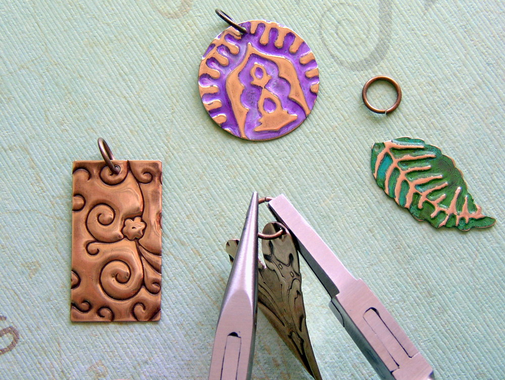 Add a large jump ring to the embossed and etched blanks to turn them into usable charms.