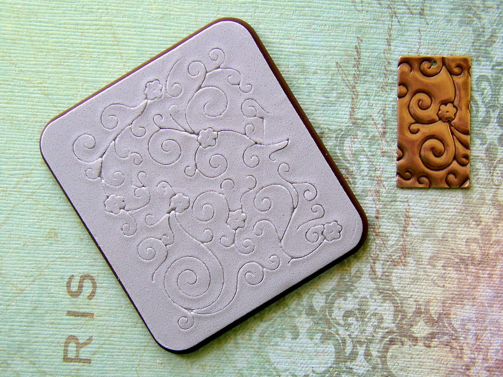 Vintaj BIGkick DecoEtch dies from Rings & Things add metal-stamped texture to metal blanks.