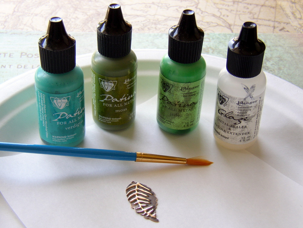 Add Vintaj patina inks to metal to create a faux-metal-enamel effect.