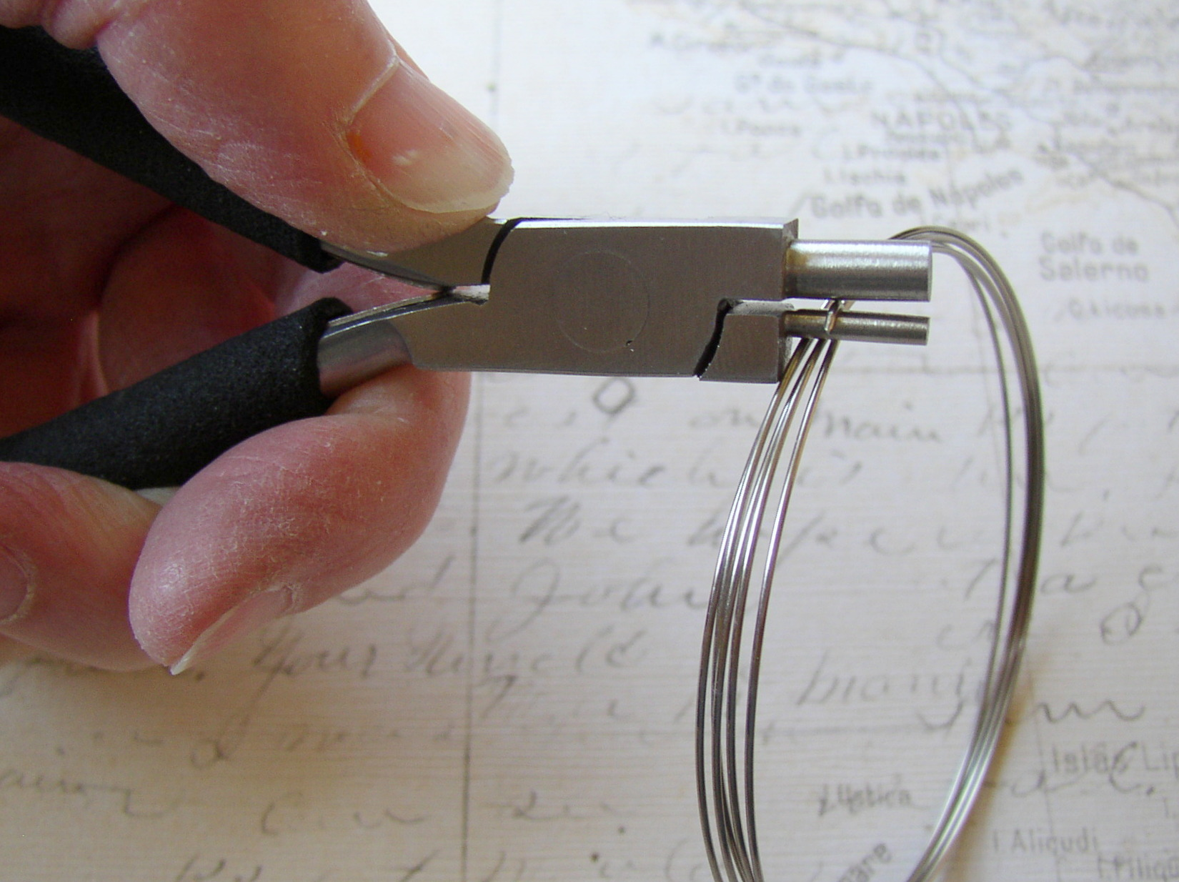 How to bend a loop in memory wire with bending pliers.