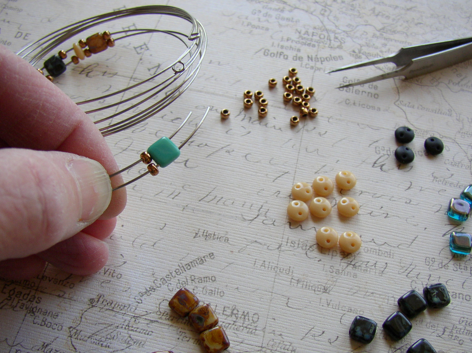 String Czechmate beads on the memory wire and add size 8/0 Czech glass seed beads.