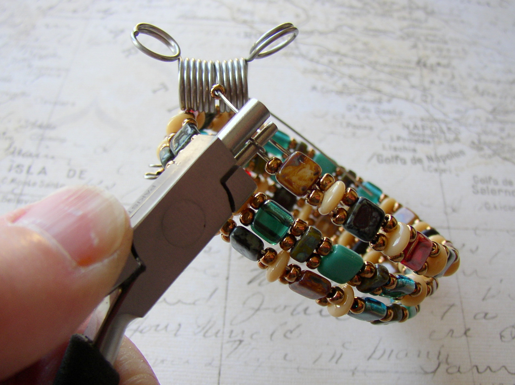 Finish the memory wire napkin ring by forming loops on each end.