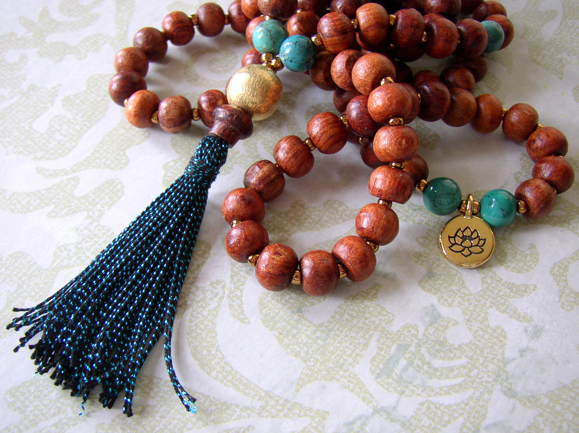 A finished Mala necklace can be used for prayer, meditation, and worn.