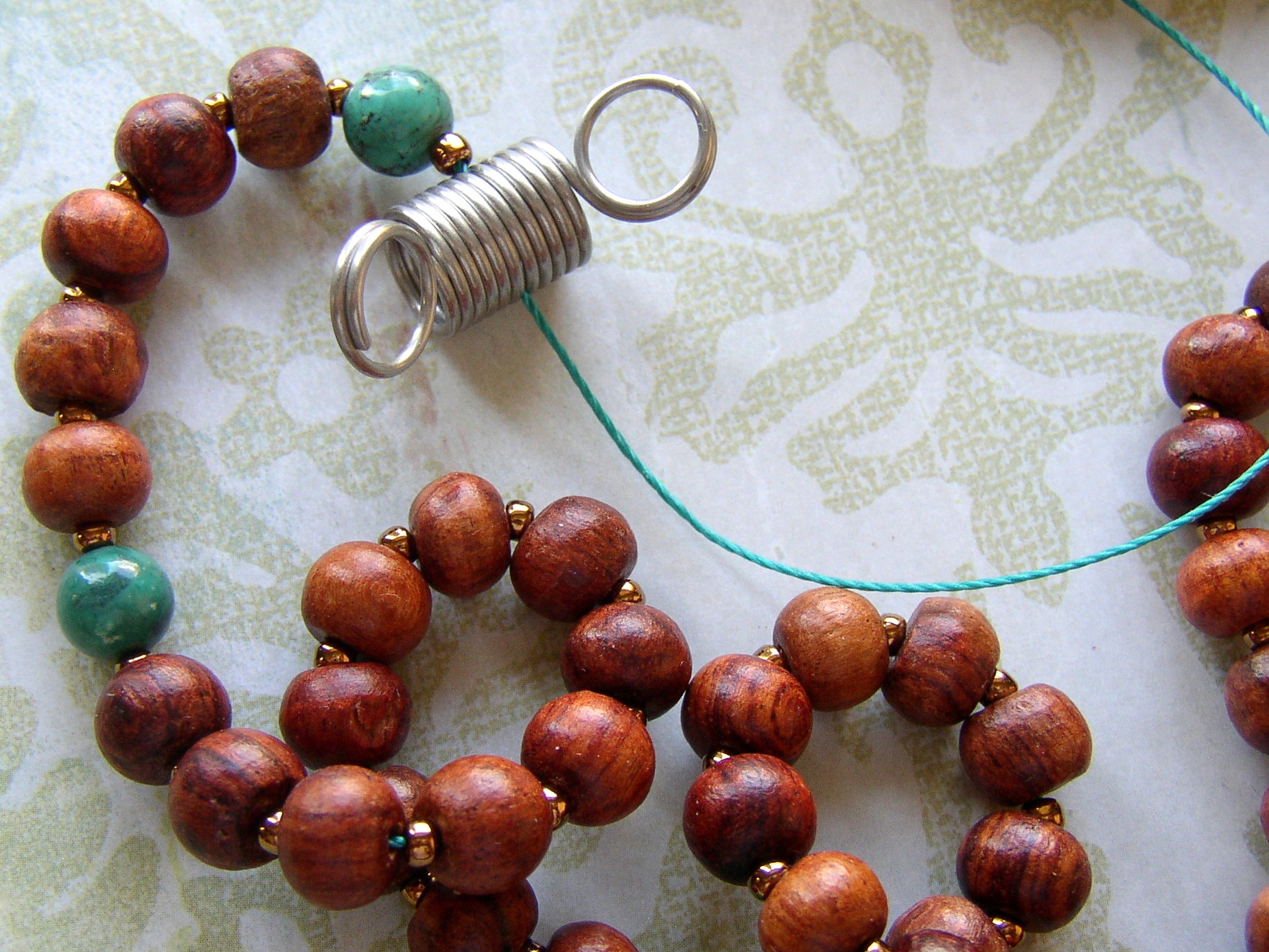 When making a prayer bead Mala, use Bead Stoppers to keep the beads in place.