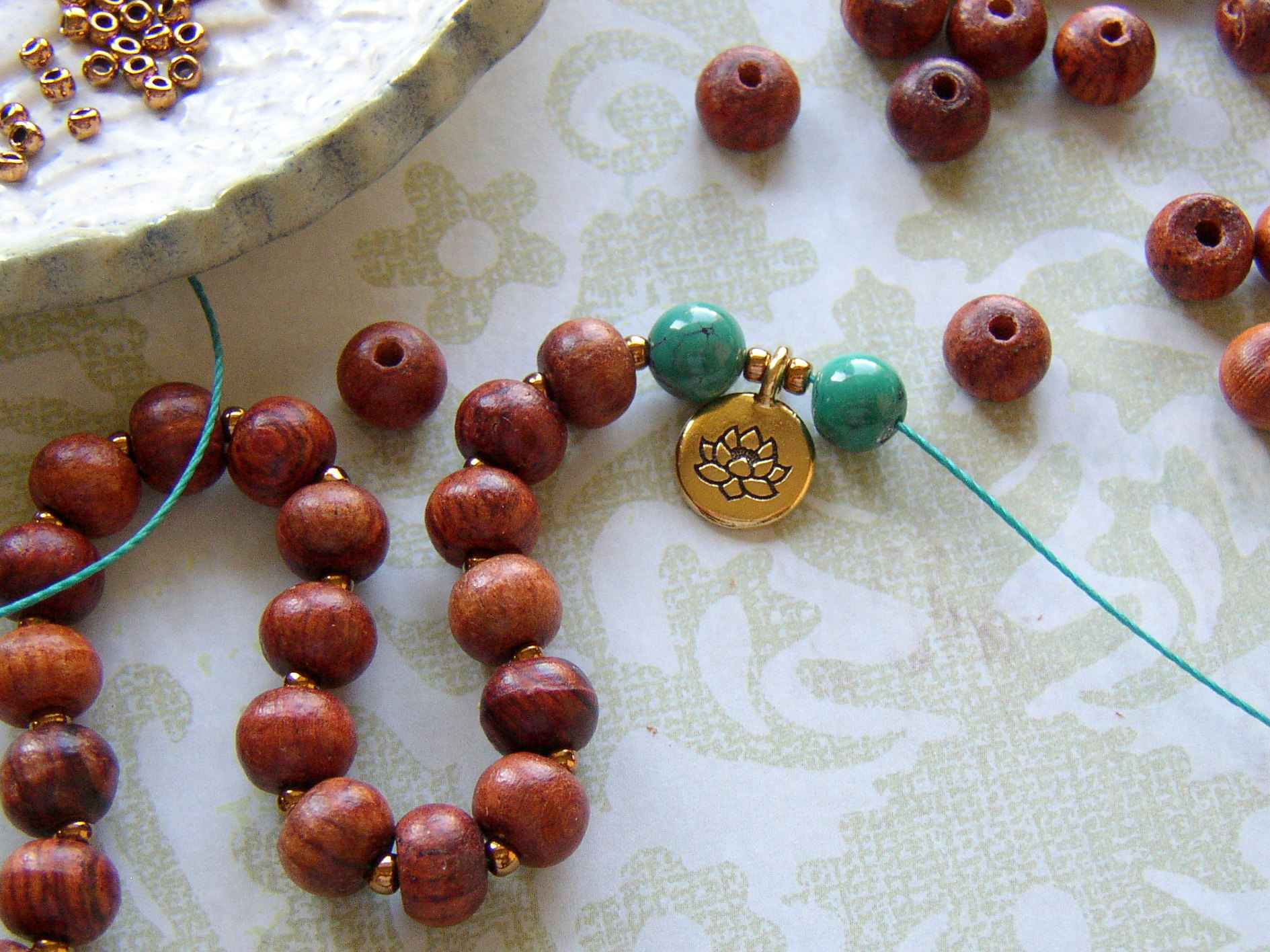 Add a lotus charm at the half-way point for the handstrung Mala.