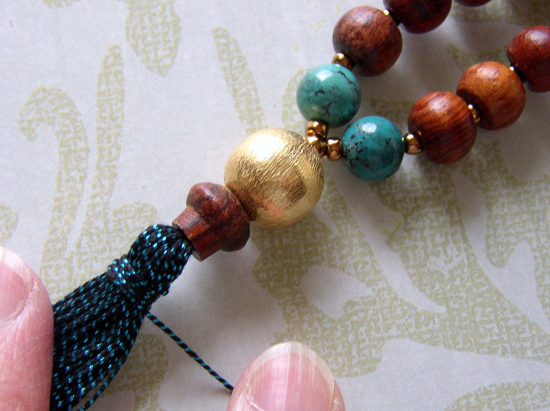 Wrap the tassel cord around the tassel to finish it,
