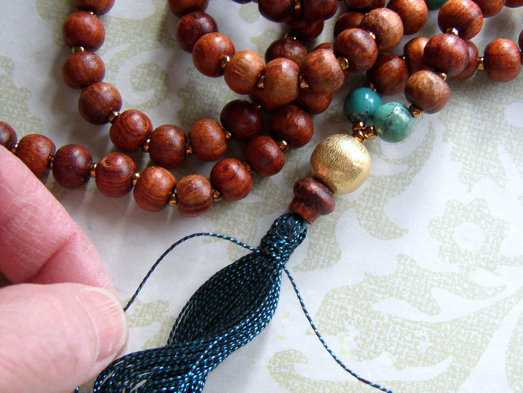 Make a yoga necklace with handmade tassel.