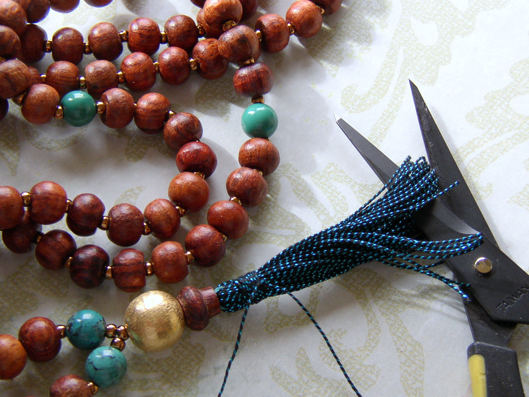 Make a yoga bead necklace with tassel.