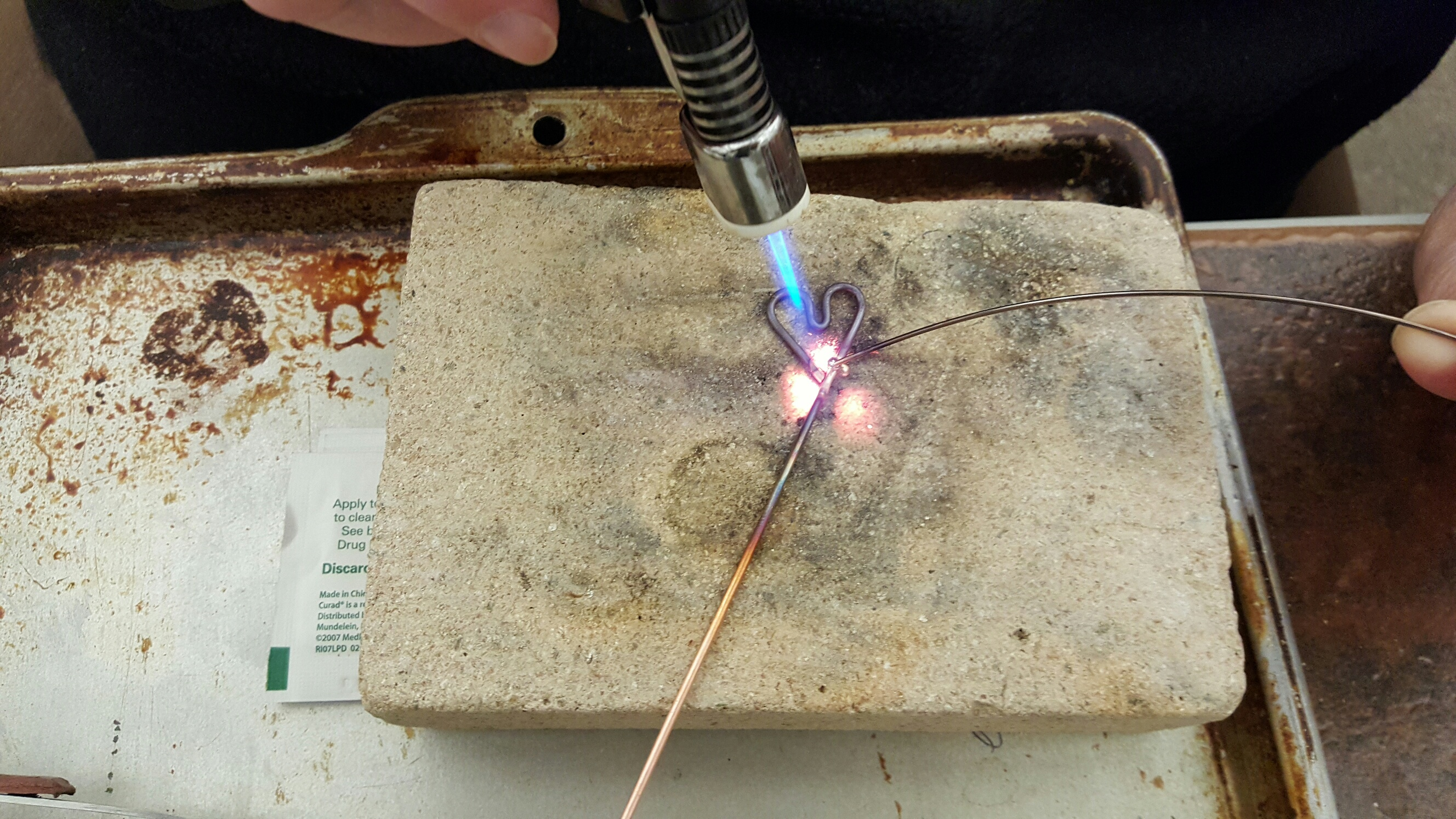 Solder flowing for copper heart bracelet