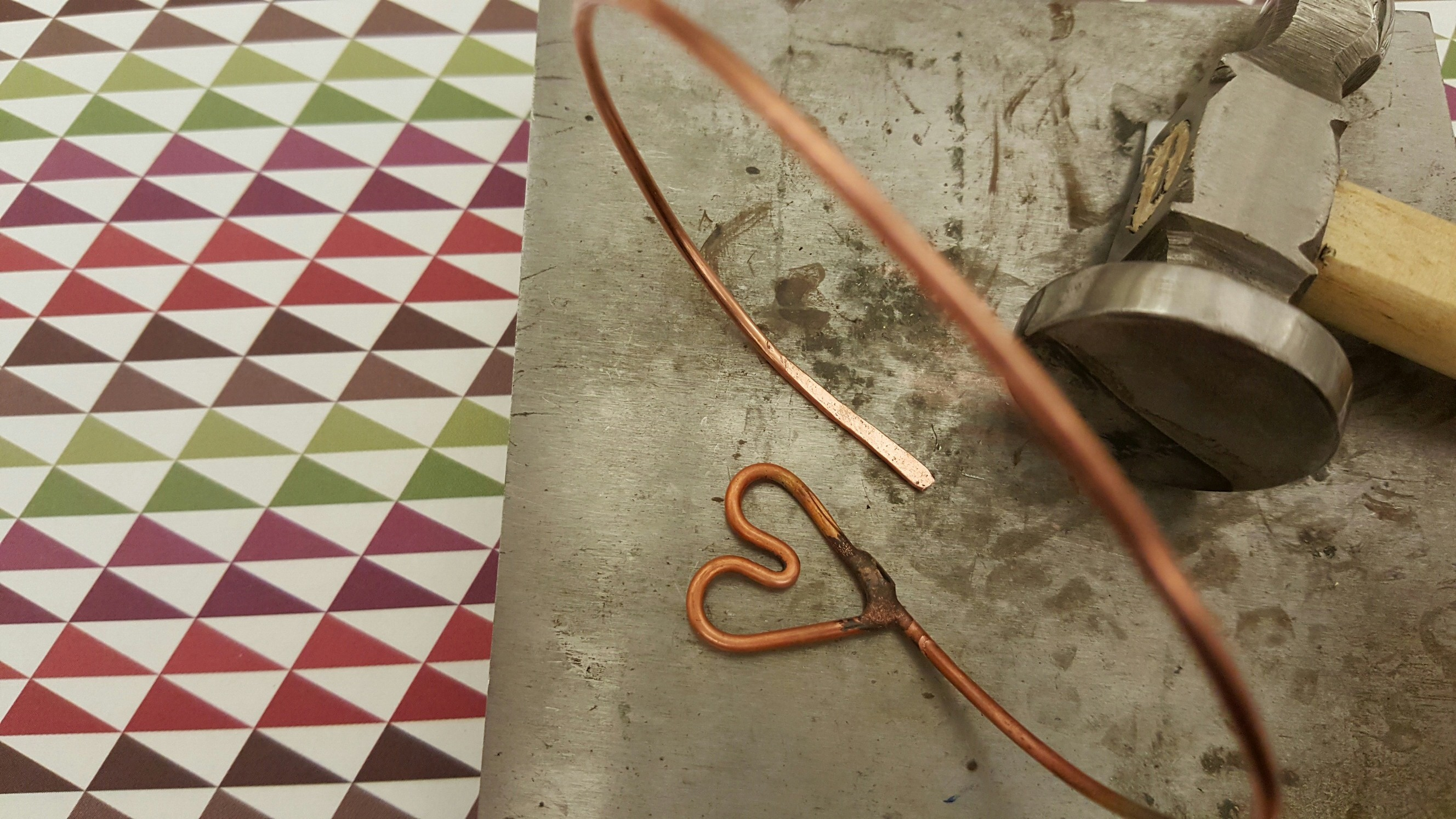 Flatten and harden the end of the wire to form a hook