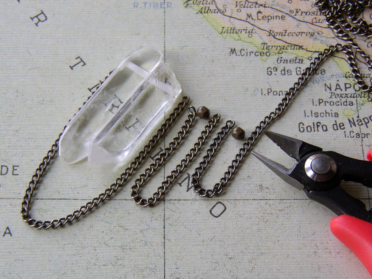 How to make a curb chain necklace with swagged chain and rock crystal points.